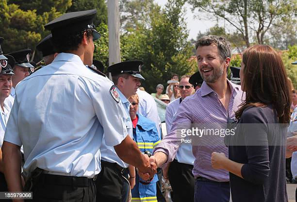 Princess Mary and Prince Frederik of Denmark meet volunteer firefighters at the Winmalee Fire Station on October 27 2013 in Winmalee Australia Prince...