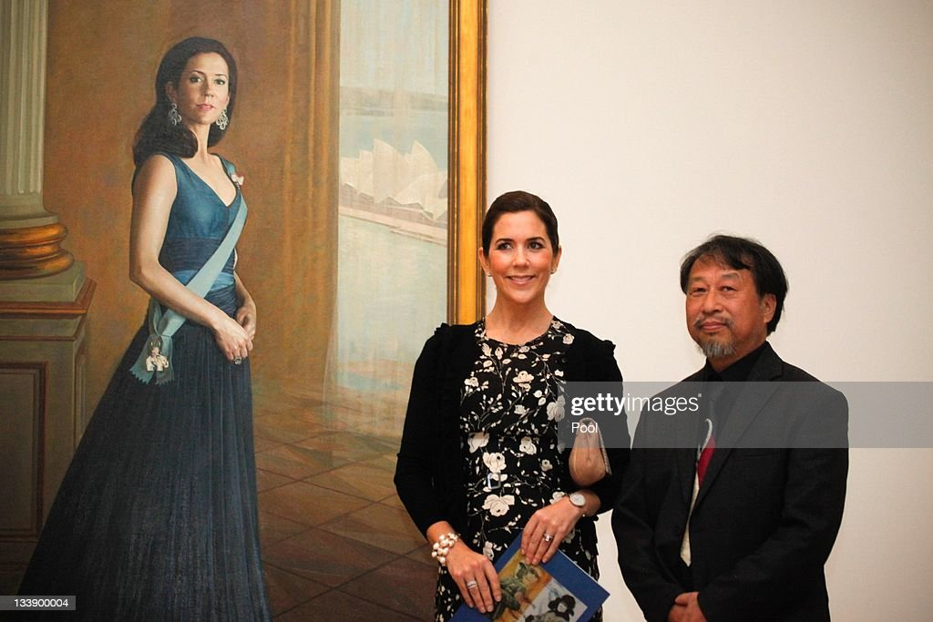 Princess Mary of Denmark (L) and artist Jiawei Shen pose next to a painting of Princess Mary at the Portrait Gallery in Canberra on November 22, 2011 in Canberra, Australia. Princess Mary and Prince Frederik are on their first official visit to Australia since 2008. The Royal visit begins in Sydney, before heading to Melbourne, Canberra and Broken Hill.