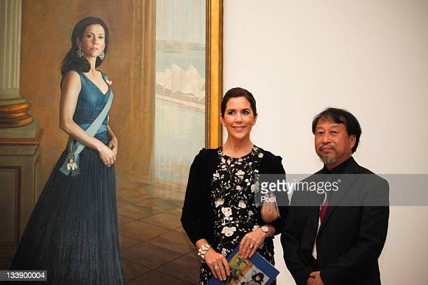 Princess Mary of Denmark and artist Jiawei Shen pose next to a painting of Princess Mary at the Portrait Gallery in Canberra on November 22 2011 in...