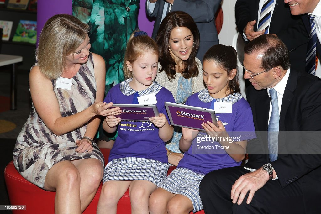 Princess Mary of Denmark and Australian Prime Minister, <a gi-track='captionPersonalityLinkClicked' href=/galleries/search?phrase=Tony+Abbott&family=editorial&specificpeople=220956 ng-click='$event.stopPropagation()'>Tony Abbott</a> look on as young school students browse the internet at the launch of eSmart Homes Digital License, The Alannah and Madeline Foundation on October 26, 2013 in Sydney, Australia. Prince Frederik and Princess Mary will visit Sydney for five days and will attend events to celebrate the 40th anniversary of the Sydney Opera House and the Danish architect who designed the landmark, Jorn Utzen.