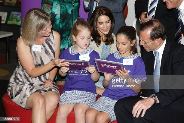 Princess Mary of Denmark and Australian Prime Minister Tony Abbott look on as young school students browse the internet at the launch of eSmart Homes...