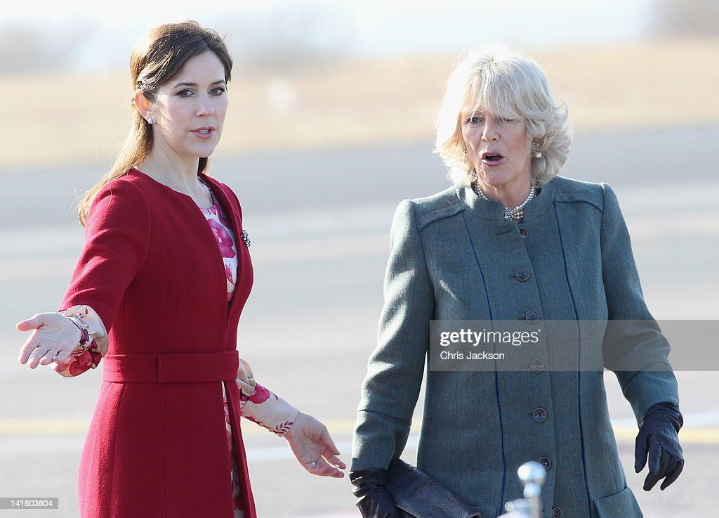 Princess Mary of Denmark and Camilla, Duchess of Cornwall talk at Copenhagen Kastrup Airport on March 24, 2012 in Copenhagen, Denmark. Prince Charles, Prince of Wales and Camilla, Duchess of Cornwall are on a Diamond Jubilee tour of Scandinavia that takes in Norway, Sweden and Denmark.