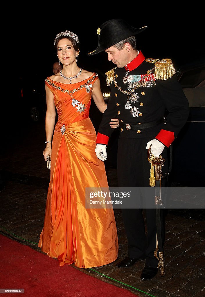 Princess Mary of Denmark and Crown <a gi-track='captionPersonalityLinkClicked' href=/galleries/search?phrase=Prince+Frederik+of+Denmark&family=editorial&specificpeople=171286 ng-click='$event.stopPropagation()'>Prince Frederik of Denmark</a> arrive at a New Year's Banquet hosted by Queen Margrethe of Denmark at Christian VII's Palace on January 1, 2013 in Copenhagen, Denmark.