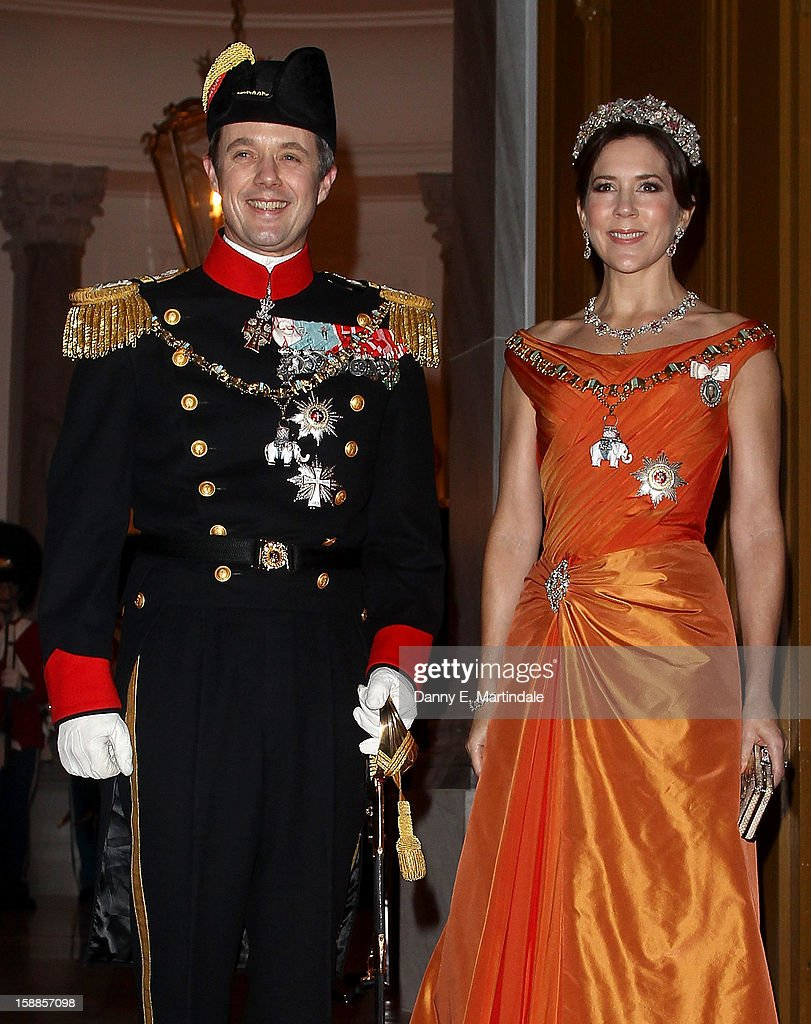 Princess Mary of Denmark and Crown <a gi-track='captionPersonalityLinkClicked' href=/galleries/search?phrase=Prince+Frederik+of+Denmark&family=editorial&specificpeople=171286 ng-click='$event.stopPropagation()'>Prince Frederik of Denmark</a> arrives at a New Year's Banquet hosted by Queen Margrethe of Denmark at Christian VII's Palace on January 1, 2013 in Copenhagen, Denmark.