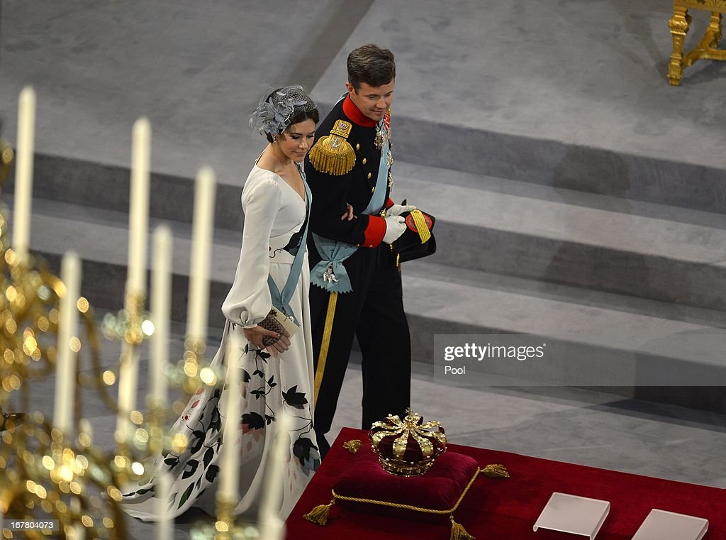Princess Mary of Denmark and Prince Frederik of Denmark (R) leave after the inauguration ceremony for King Willem-Alexander of the Netherlands at Nieuwe Kerk on April 30, 2013 in Amsterdam, Netherlands.