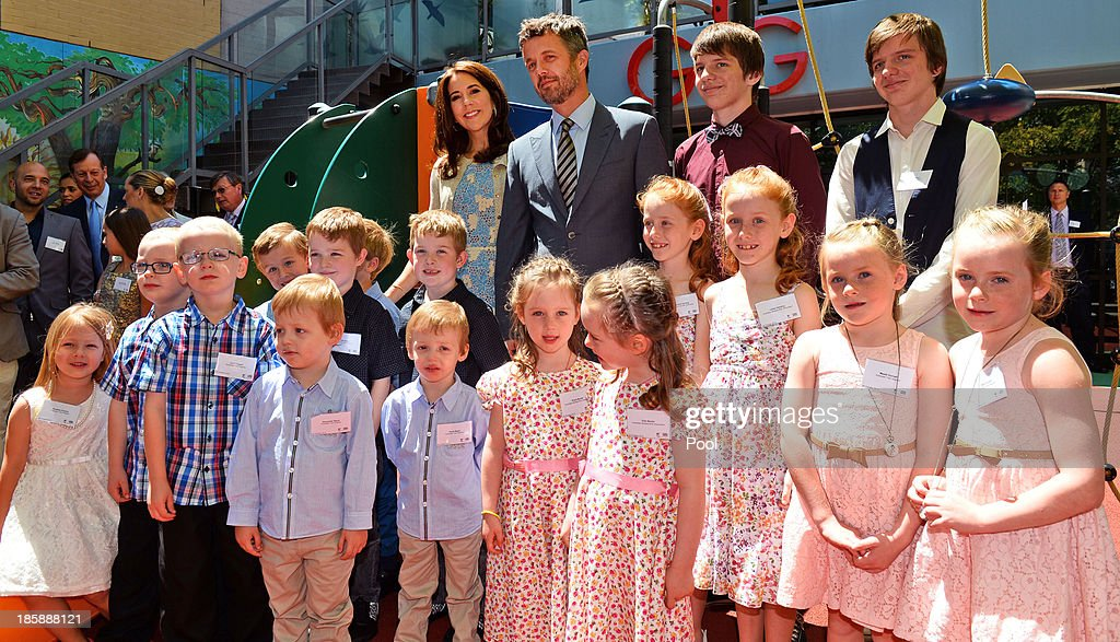 Princess Mary of Denmark and <a gi-track='captionPersonalityLinkClicked' href=/galleries/search?phrase=Prince+Frederik+of+Denmark&family=editorial&specificpeople=171286 ng-click='$event.stopPropagation()'>Prince Frederik of Denmark</a> pose for a photo with identical twins during a visit to the Australian Twin Registry (ATR) at the Sydney Children's Hospital on October 26, 2013 in Sydney, Australia. Prince Frederik and Princess Mary will visit Sydney for five days and will attend events to celebrate the 40th anniversary of the Sydney Opera House and the Danish architect who designed the landmark, Jorn Utzen.