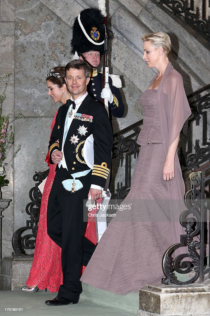 Princess Mary of Denmark, Crown <a gi-track='captionPersonalityLinkClicked' href=/galleries/search?phrase=Prince+Frederik+of+Denmark&family=editorial&specificpeople=171286 ng-click='$event.stopPropagation()'>Prince Frederik of Denmark</a> and Princess <a gi-track='captionPersonalityLinkClicked' href=/galleries/search?phrase=Charlene+-+Princess+of+Monaco&family=editorial&specificpeople=726115 ng-click='$event.stopPropagation()'>Charlene</a> of Monaco depart from the wedding of Princess Madeleine of Sweden and Christopher O'Neill hosted by King Carl Gustaf XIV and Queen Silvia at The Royal Palace on June 8, 2013 in Stockholm, Sweden.