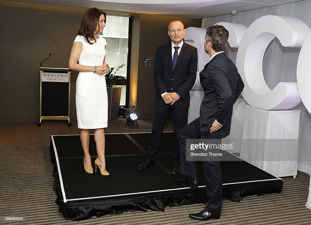 Princess Mary of Denmark, General Manager ECCO Shoes, Morten Lauge and Prince Frederik of Denmark speak at an offical ceremony of the Diploma of the Danish Export Association and His Royal Highness Prince Henrik's Medal of Honour to ECCO Shoes Pacific on October 28, 2013 in Sydney, Australia. Prince Frederik and Princess Mary will visit Sydney for five days and will attend events to celebrate the 40th anniversary of the Sydney Opera House and the Danish architect who designed the landmark, Jorn Utzen.