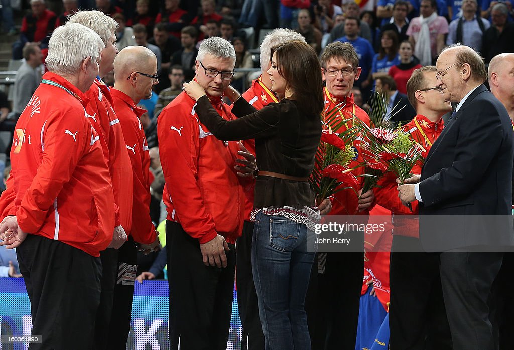 Princess Mary of Denmark handles the silver medals to the danish players after the Men's Handball World Championship 2013 final match between Spain and Denmark at Palau Sant Jordi on January 27, 2013 in Barcelona, Spain.