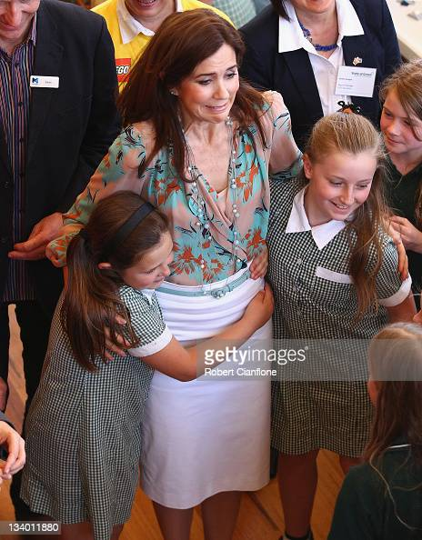 Princess Mary of Denmark is hugged by children as she visits ART Play to view the Lego competition 'Build the Change' on November 24 2011 in...