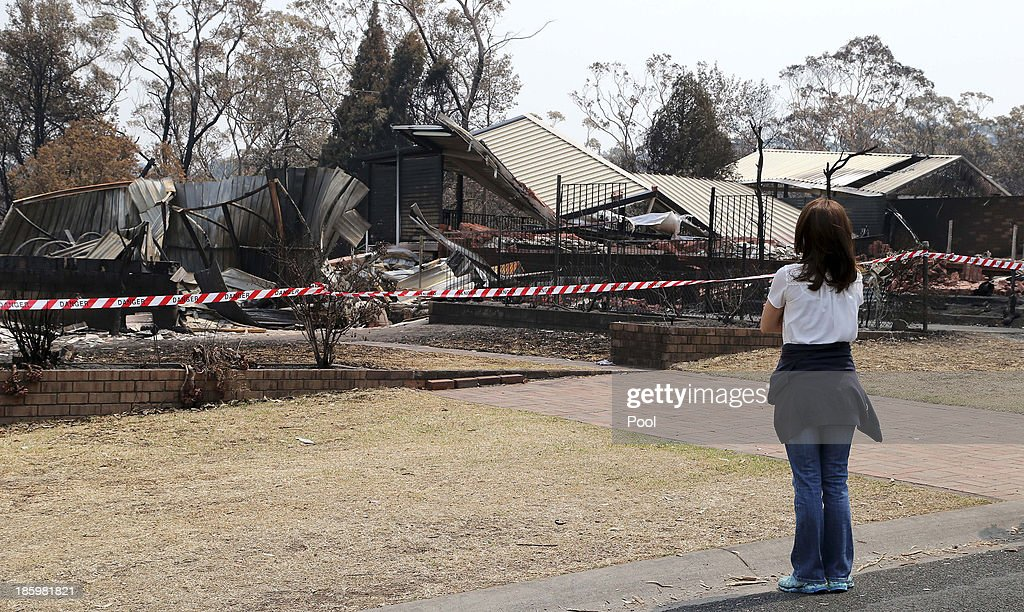 Princess Mary of Denmark looks at bush fire devastation on October 27, 2013 in Winmalee, Australia. Prince Frederik and Princess Mary will visit Sydney for five days and will attend events to celebrate the 40th anniversary of the Sydney Opera House and the Danish architect who designed the landmark, Jorn Utzen.