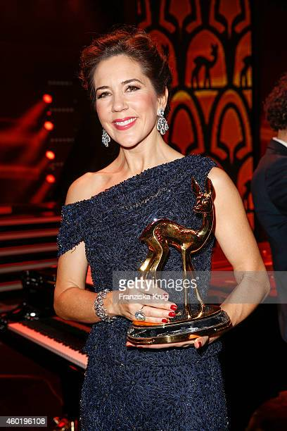 Princess Mary of Denmark poses with her award after the Bambi Awards 2014 show on November 14 2014 in Berlin Germany