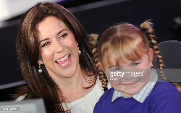 Princess Mary of Denmark of Denmark poses with sixyearold Thalia Cheail at an event for the Alannah and Madeline Foundation on November 26 2011 in...