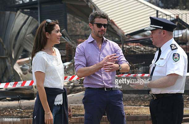 Princess Mary of Denmark Prince Frederik of Denmark and NSW RFS Commissioner Shane Fitzsimmons speak during a tour of bush fire devastation October...
