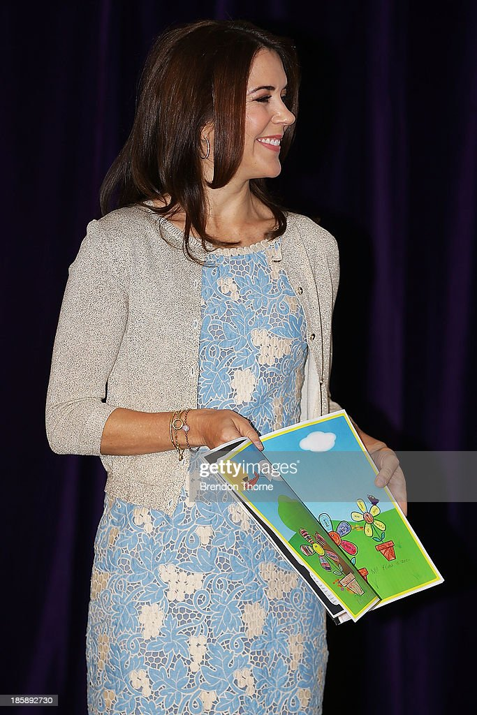 Princess Mary of Denmark reads a book received as a gift from a young school student at the launch of eSmart Homes Digital License, The Alannah and Madeline Foundation on October 26, 2013 in Sydney, Australia. Prince Frederik and Princess Mary will visit Sydney for five days and will attend events to celebrate the 40th anniversary of the Sydney Opera House and the Danish architect who designed the landmark, Jorn Utzen.