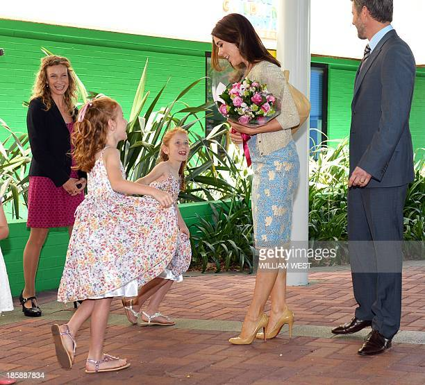 Princess Mary of Denmark receives a curtsey from identical twins Lillian and Charlotte Harding as the royal couple arrive for a visit to the...