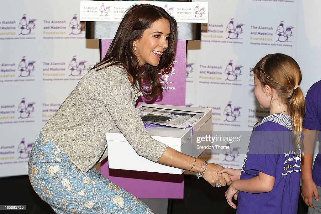 Princess Mary of Denmark receives a gift from a young school student at the launch of eSmart Homes Digital License, The Alannah and Madeline Foundation on October 26, 2013 in Sydney, Australia. Prince Frederik and Princess Mary will visit Sydney for five days and will attend events to celebrate the 40th anniversary of the Sydney Opera House and the Danish architect who designed the landmark, Jorn Utzen.
