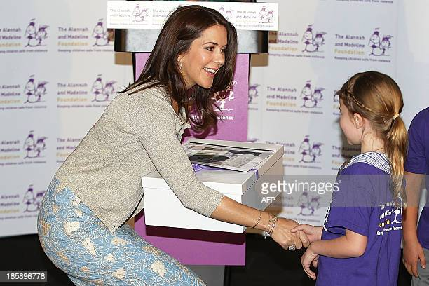 Princess Mary of Denmark receives a gift from a young school student at the launch of eSmart Homes Digital License an initiative of The Alannah and...