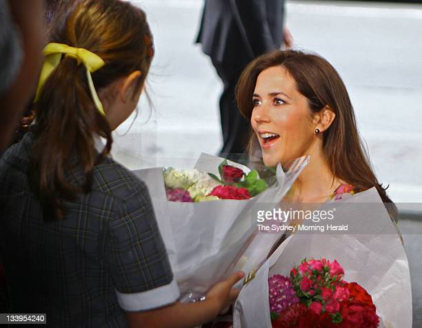 Princess Mary of Denmark of Denmark receives flowers from a school girl at the Sofitel Hotel on November 21 2011 in Sydney Australia