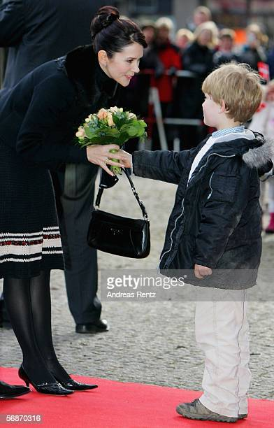Princess Mary of Denmark shakes hands with a child on her arrival at the Kunsthalle museum 17 February 2006 in Hamburg northern Germany The royal...