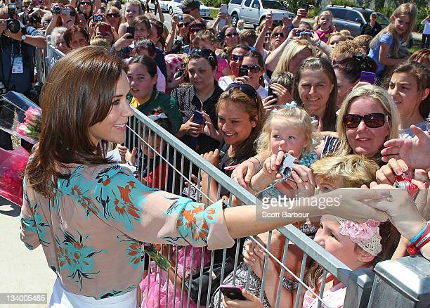 Princess Mary of Denmark shakes hands with the crowds of people after touring an environmentallyfriendly building at Pakenham Springs Primary School...