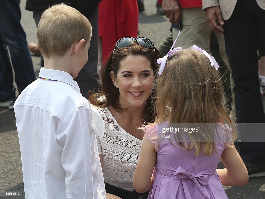 Princess Mary of Denmark speaks to young children on the street during a tour of bush fire devastation October 27, 2013 in Winmalee, Australia. Prince Frederik and Princess Mary will visit Sydney for five days and will attend events to celebrate the 40th anniversary of the Sydney Opera House and the Danish architect who designed the landmark, Jorn Utzen.