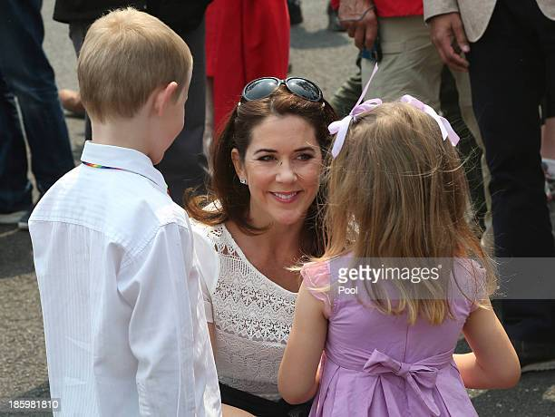 Princess Mary of Denmark speaks to young children on the street during a tour of bush fire devastation October 27 2013 in Winmalee Australia Prince...
