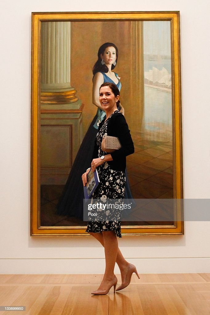 Princess Mary of Denmark stands in front of a painting of herself painted by artist Jiawei Shen (Not Pictured) at the Portrait Gallery in Canberra on November 22, 2011 in Canberra, Australia. Princess Mary and Prince Frederik are on their first official visit to Australia since 2008. The Royal visit begins in Sydney, before heading to Melbourne, Canberra and Broken Hill.