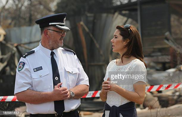 Princess Mary of Denmark talks with NSW Rural FireService Superintendent David Jone while touring the bush fire devastation in Winmalee on October 27...