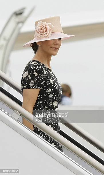 Princess Mary of Denmark walks down a staircase as she arrives at Fairbairn Defence Establishment on November 22 2011 in Canberra Australia Princess...