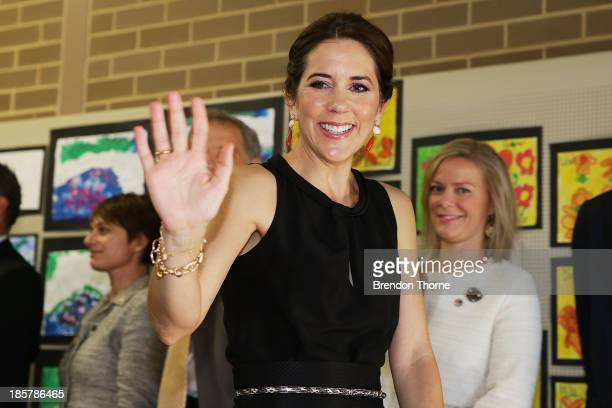Princess Mary of Denmark waves to school children after attending the Premier's Reading Challenge at Five Dock primary school on October 25 2013 in...
