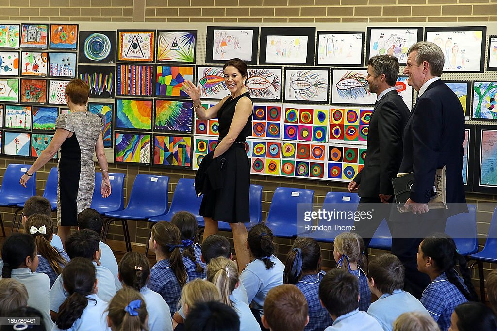 Princess Mary of Denmark waves to school children at the Premier's Reading Challenge at Five Dock primary school on October 25, 2013 in Sydney, Australia. Prince Frederik and Princess Mary will visit Sydney for five days and will attend events to celebrate the 40th anniversary of the Sydney Opera House and the Danish architect who designed the landmark, Jorn Utzen.