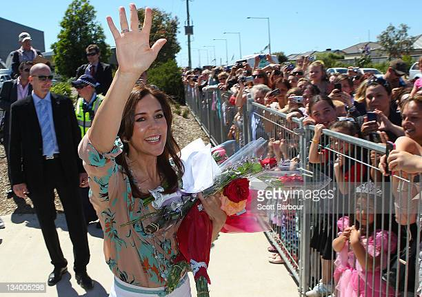 Princess Mary of Denmark waves to the crowd of people after touring an environmentallyfriendly building at Pakenham Springs Primary School on...