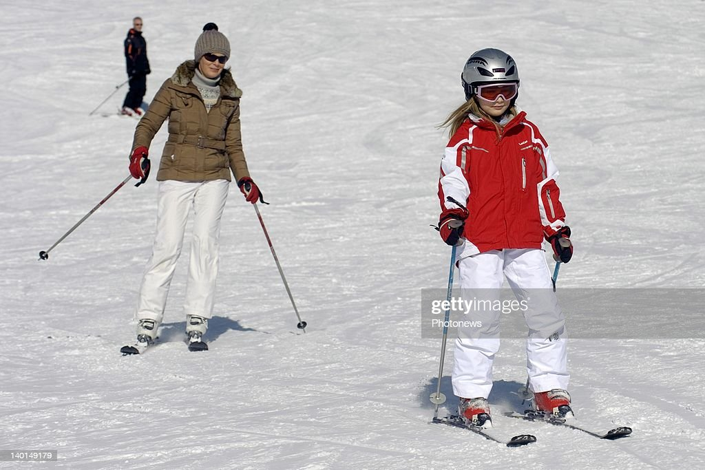 VERBIER , SWITZERLAND - FEBRUARY 22, 2012: Princess Mathilde and daughter Princess Elizabeth on the ski slopes during the Royal Family Skiing Holiday on February 22,2012 in Verbier,Switzerland.