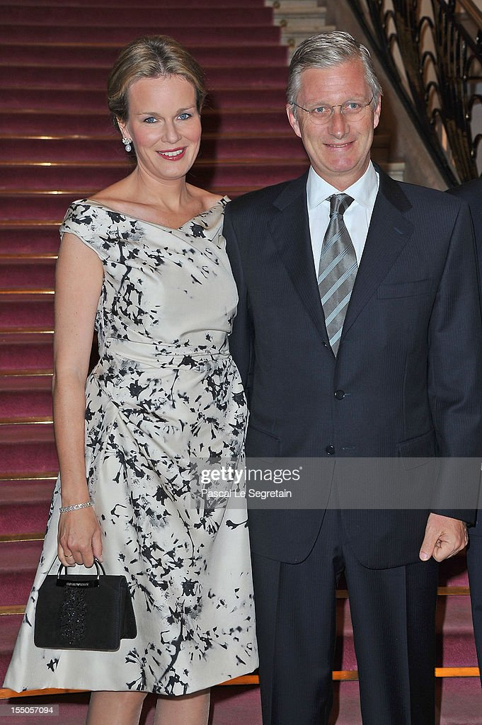 Princess Mathilde (L) and Prince Philippe of Belgium (C) at Theatre des Champs-Elysees on October 31, 2012 in Paris, France.