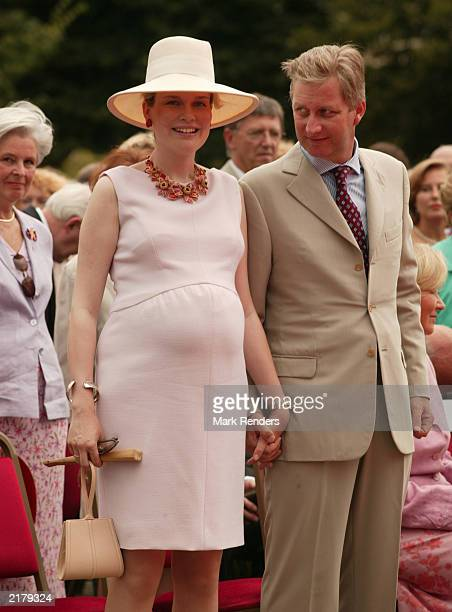 Princess Mathilde and Prince Philippe of Belgium attend the garden party to celebrate the 10 year reign of Belgium's King Albert II at the Royal...