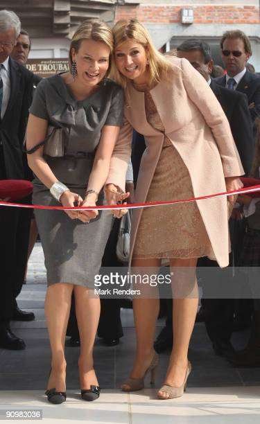 Princess Mathilde from Belgium and Princess Maxima from The Netherlands cut the red ribbon to inaugurate the 'M' Museum on September 20 2009 in...