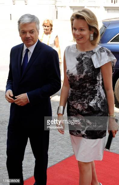 Princess Mathilde of Belgium and Minister of Foreign Affairs Didier Reynders attend the 'FAshion@Egmontpalace' exhibition on July 17 2013 in Brussels...