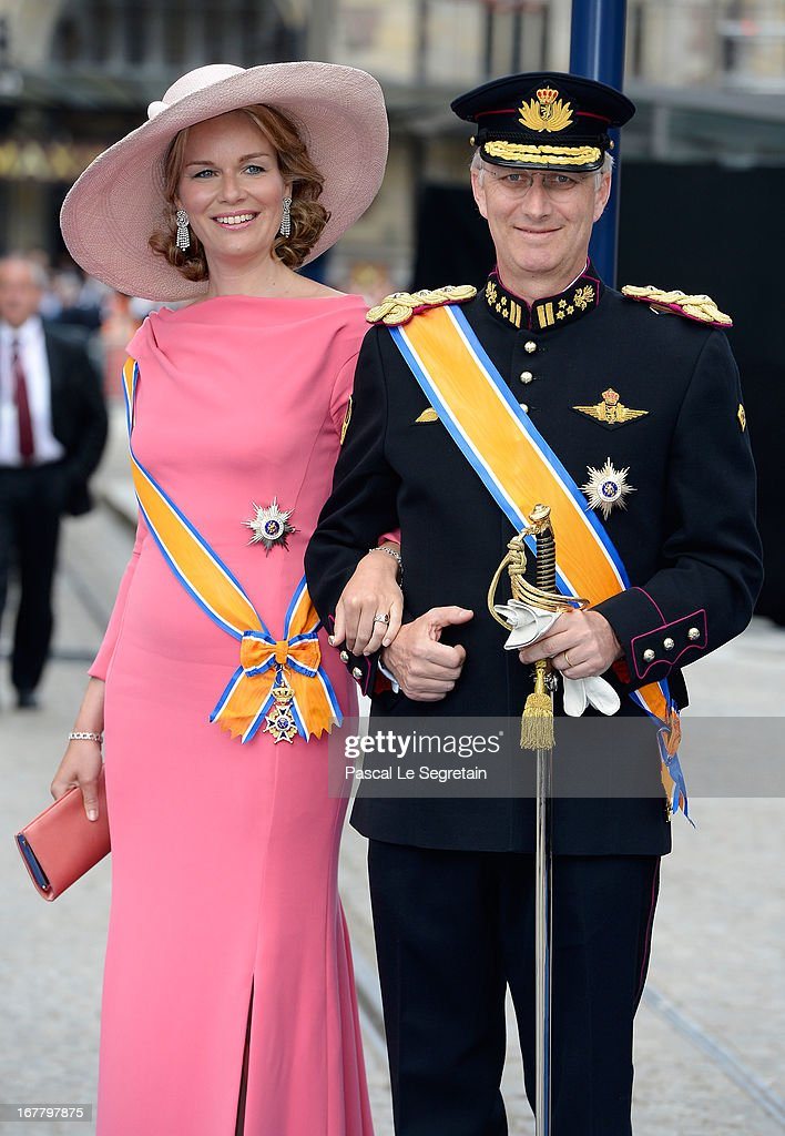 Princess Mathilde of Belgium and Prince <a gi-track='captionPersonalityLinkClicked' href=/galleries/search?phrase=Philippe+of+Belgium&family=editorial&specificpeople=160209 ng-click='$event.stopPropagation()'>Philippe of Belgium</a> depart the Nieuwe Kerk to return to the Royal Palace after the abdication of Queen Beatrix of the Netherlands and the Inauguration of King Willem Alexander of the Netherlands on April 30, 2013 in Amsterdam, Netherlands.