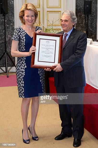 Princess Mathilde of Belgium and Professor Carlo Maria Croce pose during the ceremony for the InbevBaillet Latour awards for Health and Clinical...