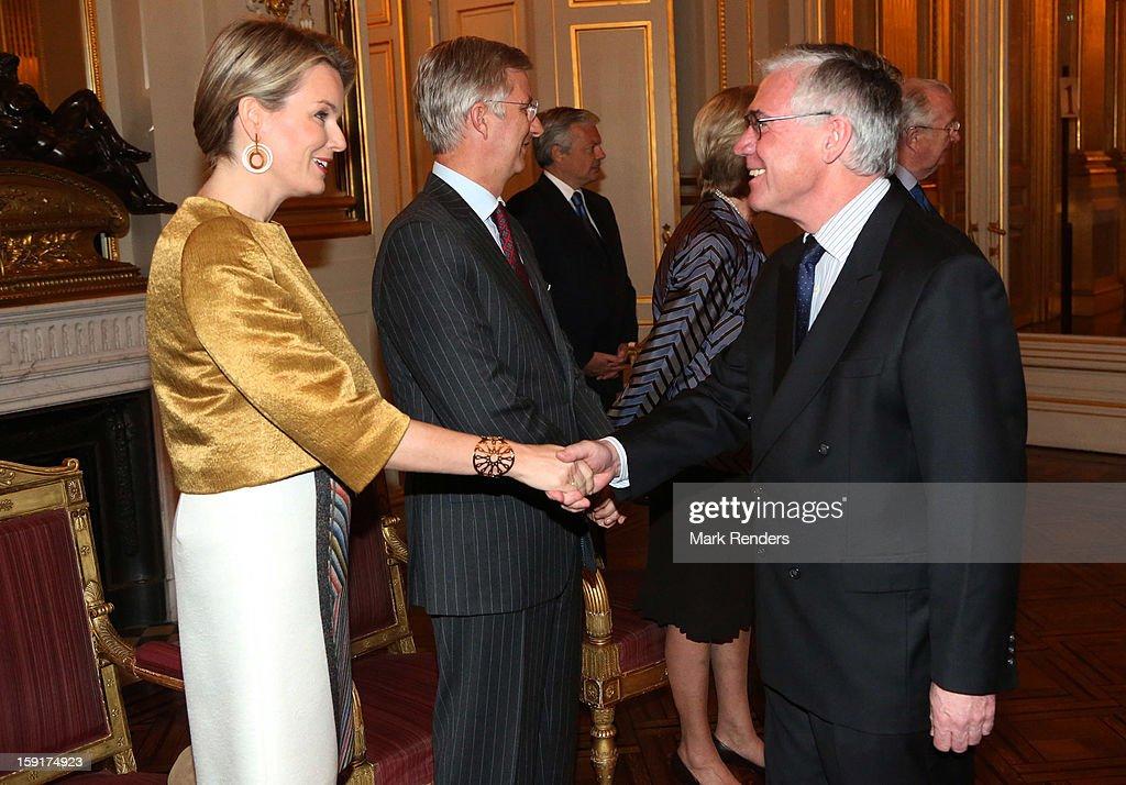 Princess Mathilde of Belgium greets meet German Ambassador Eckart Cuntz beside Prince Philippe of Belgium during a New Year reception at Palais de Bruxelles on January 9, 2013 in Brussel, Belgium.