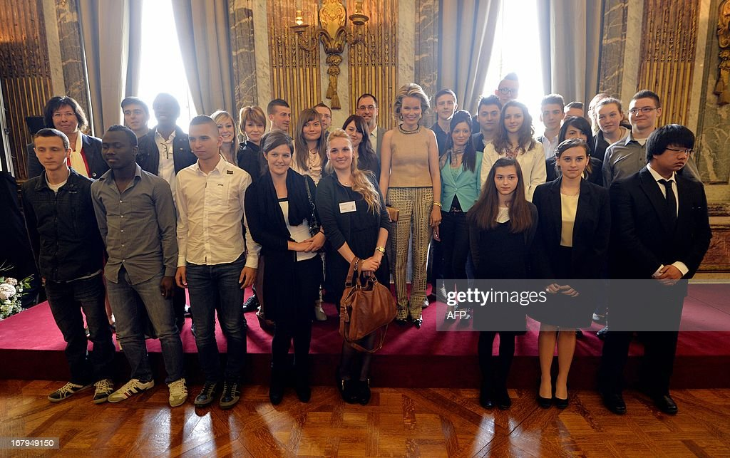 Princess Mathilde of Belgium is pictured with the laureates at the Princess Mathilde award giving ceremony, in Brussels' Royal Palace, on May 3, 2013. The Princess Mathilde award is focused this year on the role of fathers in education. AFP PHOTO / BELGA / ERIC LALMAND Belgium Out