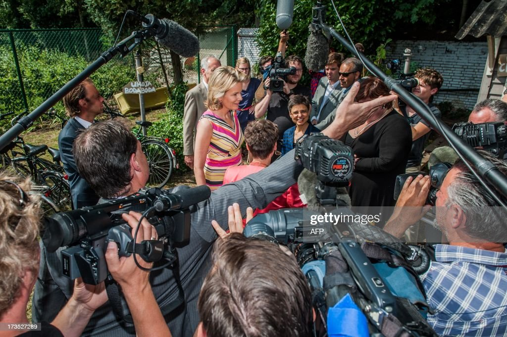 Princess Mathilde (C) of Belgium is surrounded by the press on July 16, 2013 during her visit to the House of Colors, a shelter for youths and children in crisis situations, in Vosselaar. OUT -