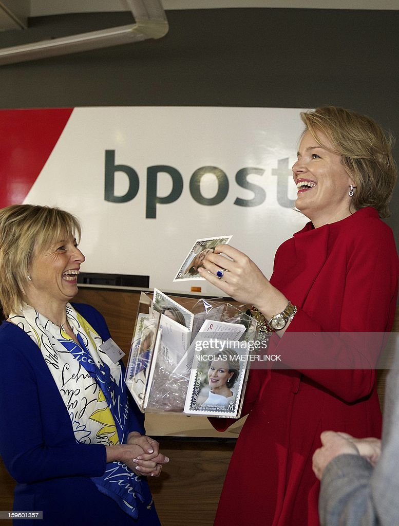 Princess Mathilde of Belgium (R) laughs as she visits the stamp printing factory of Mechelen, on January 17, 2013. The Belgian post company Bpost will release a special series of stamps to celebrate the 40th birthday of Princess Mathilde of Belgium next January 20.