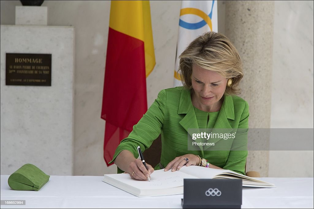 Princess Mathilde of Belgium signs the guestbook during a visit to the headquarters of the IOC on May 13, 2013 in Lausanne, Switzerland.