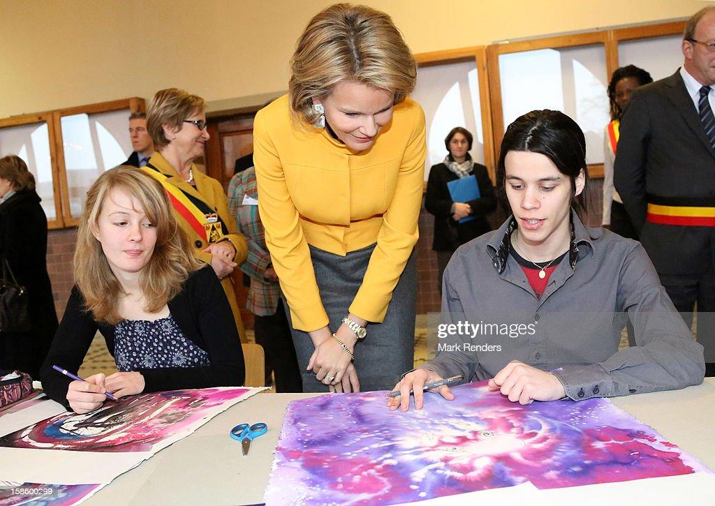 Princess Mathilde of Belgium (C) visits the CEPES School on December 20, 2012 in Jodoigne, Belgium.
