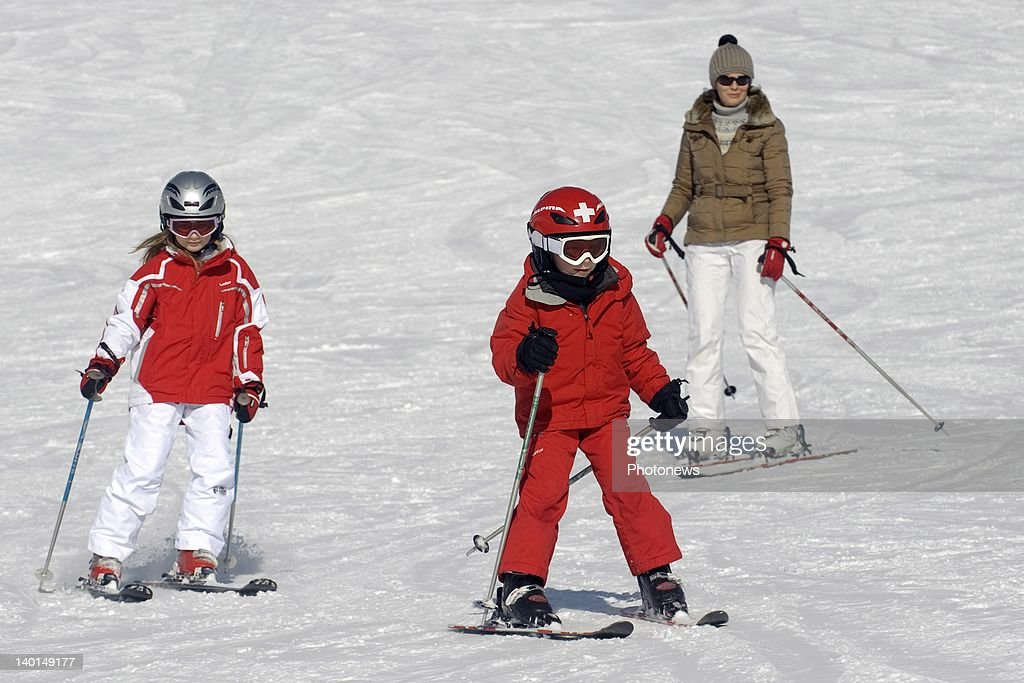 VERBIER , SWITZERLAND - FEBRUARY 22, 2012: Princess Mathilde with daughter Princess Elizabeth and son Prince Emmanuel on the ski slopes during the Royal Family Skiing Holiday on February 22,2012 in Verbier,Switzerland.