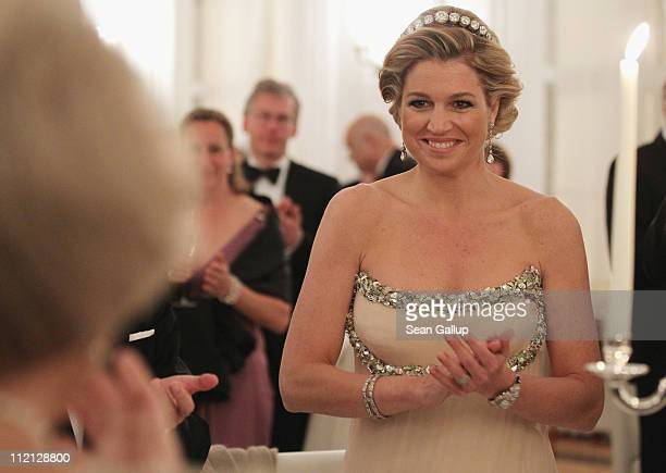 Princess Maxima of the Netherlands looks to her motherinlaw Queen Beatrix while attending a state banquet given in honour of the visiting Dutch...
