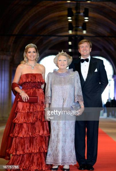 Princess Maxima of the Netherlands Queen Beatrix of the Netherlands and Prince WillemAlexander of the Netherlands arrive at a dinner hosted by Queen...