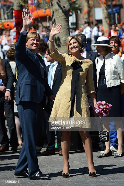Princess Maxima of the Netherlands waves next to Prince WillemAlexander during the traditional Queens Day celebrations on April 30 2012 in Veenendaal...